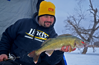 image of Jason Feldner holding Walleye on Devils Lake