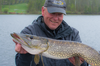 image of fishing guide with big pike