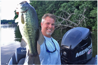 image of josh hagemeister and client with big bass