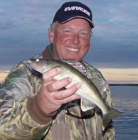 image of angler with eating size walleye