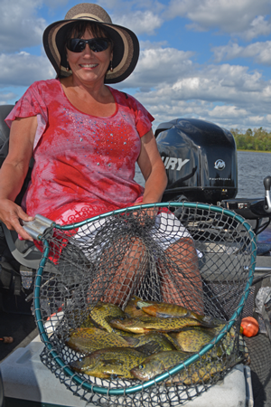 image of the hippie chick with net full of crappies
