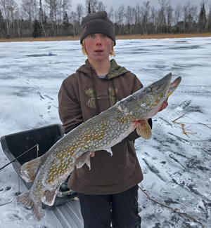 image of ice fisherman with big pike