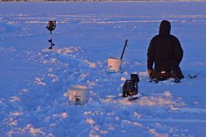 image of ice fisherman