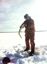 image of ice fisherman catching Pike with a tip up