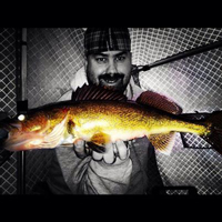 image of Jeremy Taschuk holding walleye