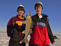image of Nate Thelen holding Walleye on Ice