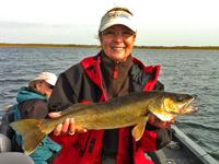 Gail Heig holding 26 inch Walleye