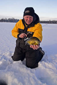image of Jeff Sundin holding Bluegill on Bass Lake