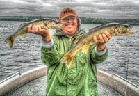 image of Rich Riemersma holding two big Walleyes
