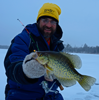image of Jeff Samsel holding Crappie on the ice