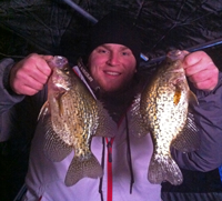 image of ice fisherman holding Crappies