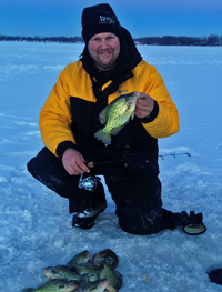 image of Jon Thelen with Crappies on the ice