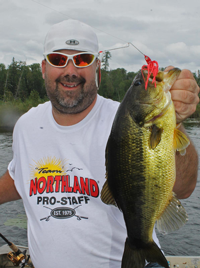 image of Jeremy Taschuk holding largemouth Bass