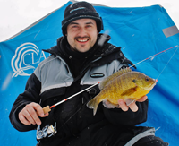image of Blake Liend holding Bluegill on ice