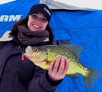 image of Amanda holding big Crappie on the ice