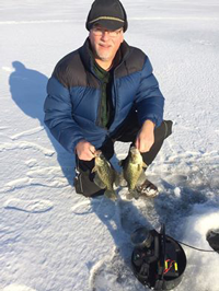 image of Bob Behrner with Crappies on the ice