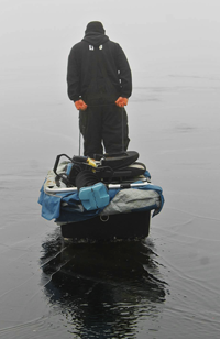 image of ice fisherman on wet ice