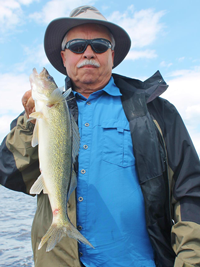 image of Terry Wickstrom holding nice Walleye