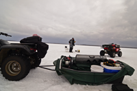 image of ATVs and Ice fisherman on ice