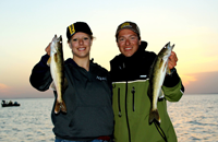 image of Nik Dimich and Becca Kent holding Walleyes