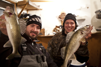 image of nik dimich and justin holding walleyes on Lake Winnie