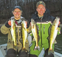 image of Nik Dimich and Becca Kent holding walleyes that they caught near Grand Rapids