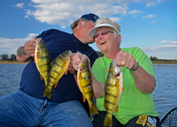 image of Karen and Kyle Reynolds with Leech Lake Perch
