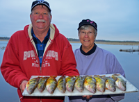 image of Fritz and Penner Becker with platter of Jumb Perch