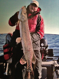 image of Wayne Crandall holding Giant Red Lake Pike
