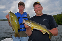 image of Mavis and Austin Jones holding fish that they caught