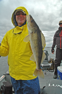 image of Cliff Hook with large Walleye on Lake Winnibigoshish