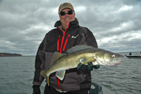 image of Mark Huelse with nice Lake Winnie Walleye