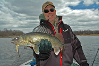 image of Mark Huelse holding large Walleye
