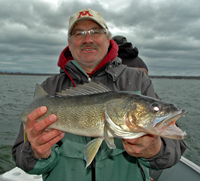 image of Tim Fischbach holding Leech Lake Walleye
