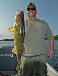 image of Kyle holding a pokegama lake walleye