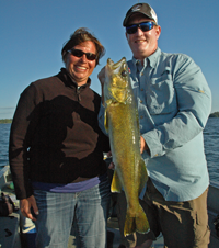 Image of Glenn Fraze holding a monster Walleye
