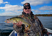 image of Marty Glackin with nice Lake Winnie Walleye
