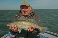 image of Kevin Scott with large Walleye on Leech Lake