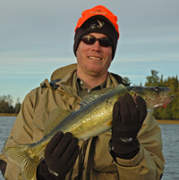 image of Zach Naylor with a nice fall walleye
