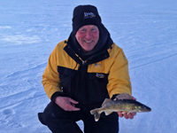 image of fishing guide Jeff Sundin holding Walleye on Winnibigoshish
