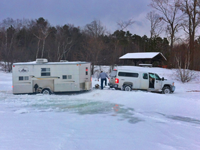 image of truck and fishing shelter stuck on the ice