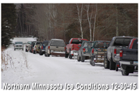 image of ice fishermen lined up at landing