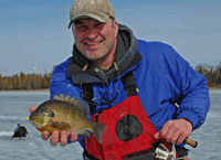 image of Robby Ott with Bluegill on ice