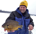 image of Jon Thelen with large Bluegill