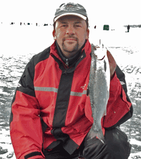 image of Brian Castellano with Coho Salmon