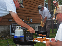 image of Jeff Skelly cooking fish