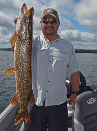 image of Jeff Minton with big Pike