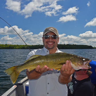 image of jeff minton with big walleye