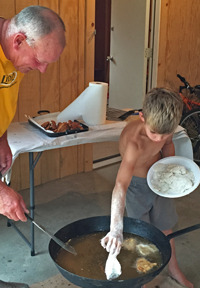 image of Owen Cheatham frying fish
