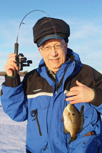 image of ice fisherman with bluegill
